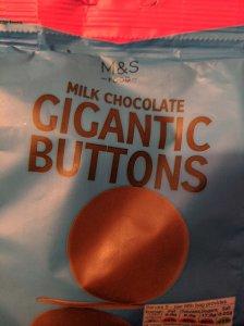 Close up of a bag of Marks and Spencers Gigantic Chocolate Buttons